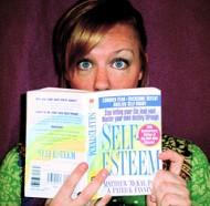 woman reading book on self-esteem